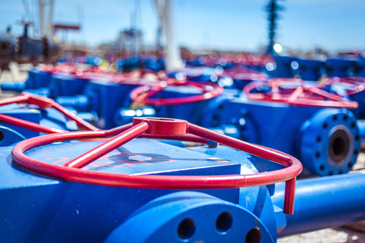 Red and blue custom Downing valves are shown in the field.