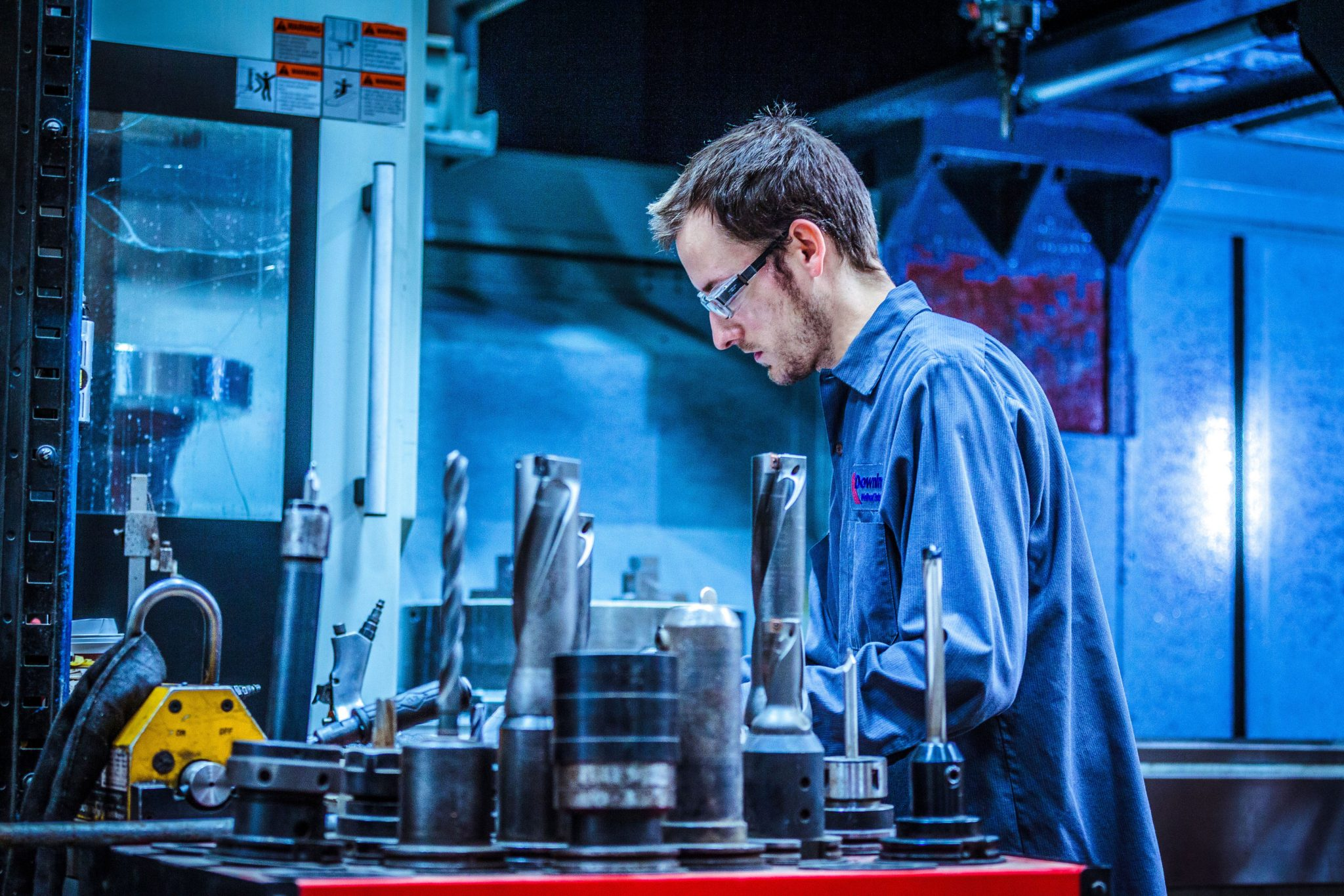 A Downing employee works on equipment in a manufacturing facility.